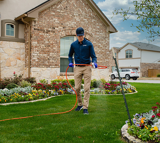 residential lawn being treated for pests